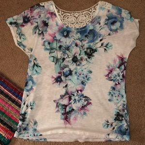Women's watercolor floral top with crochet detail